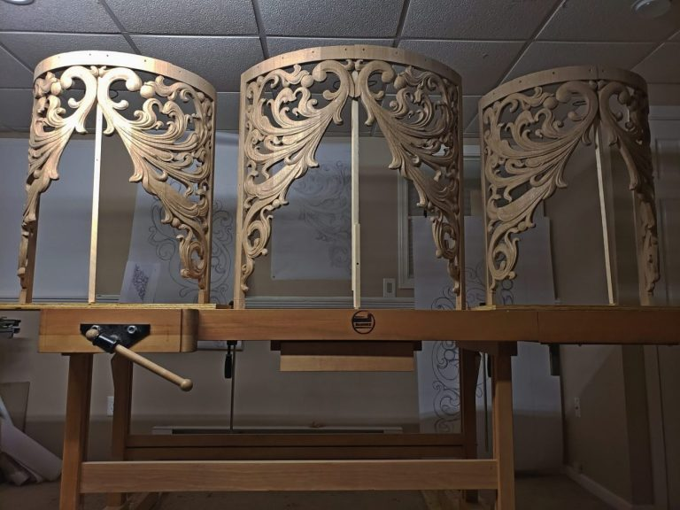 Three pipe organ round towers carvings in oak featuring openwork inspired from Gothic flamboyant period