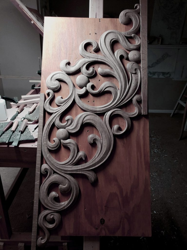 fretwork carving in oak for pipe organ case inspired from Gothic flamboyant period at woodcarver workshop