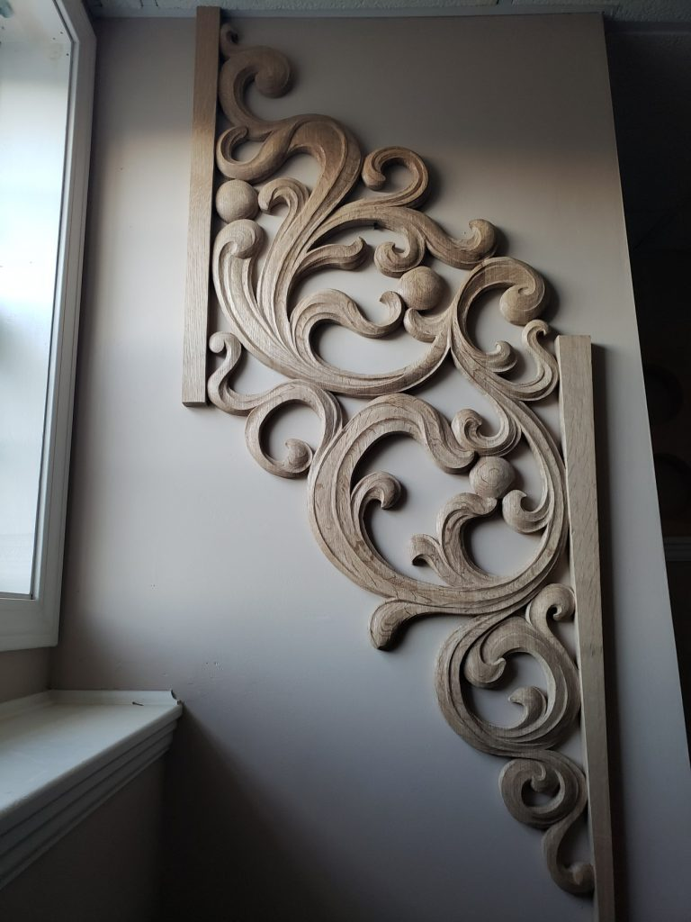 Openwork carving in oak for pipe organ case inspired from Gothic flamboyant period at woodcarver workshop