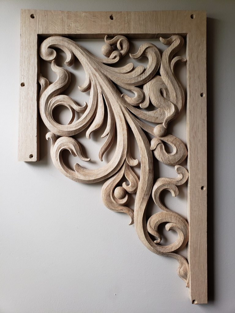 Wide pedal tower carving in oak for pipe organ with openwork inspired from Gothic flamboyant period treble side