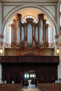 Newly built pipe organ facade including two pedal towers and three round towers decorated with oak carvings